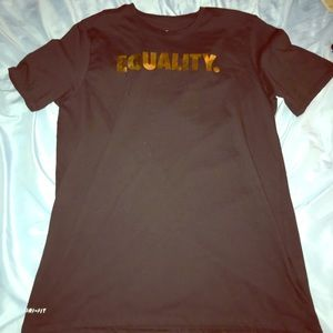 """Nike black """"equality"""" shirt with gold lettering"""